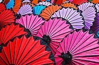 Pattern of newly assembled decorative umbrellas drying in sun, Umbrella Making Center, Bo Sang, near Chiang Mai, Thailand