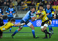 Hurricanes' Beauden Barrett and Ardie Savea (right) try to tackle Bulls Johnny Kotze during the Super Rugby quarterfinal between the Hurricanes and Bulls at Westpac Stadium in Wellington, New Zealand on Saturday, 22 June 2019. Photo: Dave Lintott / lintottphoto.co.nz