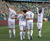 From left, Vancouver Whitecaps FC  players Eric Hassli, Davide Chiumiento, Jay DeMerit and Gershon Koffie celebrate a goal against Seattle Sounders FC during play at Qwest Field in Seattle Saturday June 11, 2011. The game ended in a 2-2 draw.