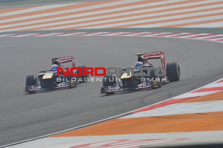 25.-27-10-2013, Jaypee-Circuit, Noida, IND, F1, Grosser Preis von Indien, Noida, im Bild Daniel Ricciardo (AUS) Scuderia Toro Rosso - Jean Eric Vergne [FRA] Scuderia Toro Rosso <br />  Foto &copy; nph / Mathis