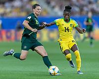 GRENOBLE, FRANCE - JUNE 18: Emily Gielnik #15 of the Australian National Team dribbles as Den-Den Blackwood #14 of the Jamaican National Team pressures during a game between Jamaica and Australia at Stade des Alpes on June 18, 2019 in Grenoble, France.