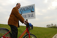 November 4, 2011  (Bladensburg, MD)  District of Columbia Mayor Vincent Gray posed for a photo op, then rode a bicycle along the Anacostia River Trail in Maryland.  Federal, state, and local officials celebrated the recent completion of 12 miles of trail in the District and 1.5 miles in Maryland with a ribbon cutting ceremony.  As part of a larger system, both trails will eventually provide nearly 60 miles of continuous trails.  The Anacostia River Watersheds' project was also selected to stimulate local economies, create local jobs, and improve quality of life under the Urban Waters Federal Partnership.    (Photo by Don Baxter/Media Images International)