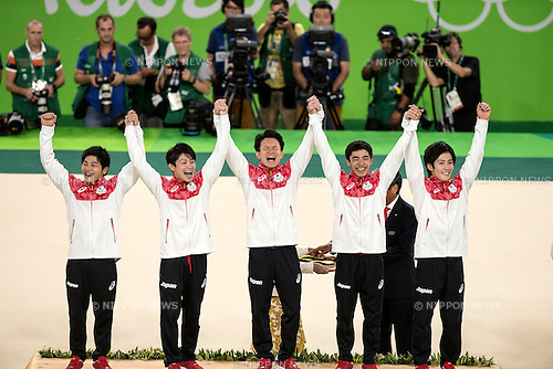 (L-R) Koji Yamamuro, Kohei Uchimura, Yusuke Tanaka, Kenzo Shirai, Ryohei Kato (JPN),<br /> AUGUST 8, 2016 - Artistic Gymnastics :<br /> Gold medalists Koji Yamamuro, Kohei Uchimura, Yusuke Tanaka, Kenzo Shirai and Ryohei Kato of Japan celebrate on the podium during the Men's Team Medal Ceremony at Rio Olympic Arena during the Rio 2016 Olympic Games in Rio de Janeiro, Brazil. (Photo by Enrico Calderoni/AFLO SPORT)