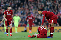 Liverpool's Andrew Robertson is consoled by Virgil van Dijk after he was grounded following a clash with Barcelona's Luis Suarez (not pictured)<br /> <br /> Photographer Rich Linley/CameraSport<br /> <br /> UEFA Champions League Semi-Final 2nd Leg - Liverpool v Barcelona - Tuesday May 7th 2019 - Anfield - Liverpool<br />  <br /> World Copyright &copy; 2018 CameraSport. All rights reserved. 43 Linden Ave. Countesthorpe. Leicester. England. LE8 5PG - Tel: +44 (0) 116 277 4147 - admin@camerasport.com - www.camerasport.com
