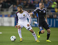 March 3rd, 2013: Olmes Garcia turns the ball away from Sam Cronin during a game at Buck Shaw Stadium, Santa Clara, Ca.  Salt Lake Real defeated San Jose Earthquakes