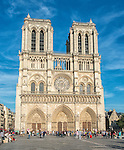View of the front of the Cathedral of Notre Dame in Paris in late afternoon, from the parvis (plaza in front).