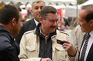 October 2, 2011  (Washington, DC)  Turkish Ambassador Tan (right) and Ankara, Turkey, Mayor Melih Gökcek (center) share a moment outside of the District Building in Washington, D.C. during the Turkish Festival.    (Photo by Don Baxter/Media Images International)