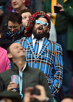 A Scotland supporter in the crowd sings their national anthem. Rugby World Cup Quarter Final between Australia and Scotland on October 18, 2015 at Twickenham Stadium in London, England. Photo by: Patrick Khachfe / Onside Images