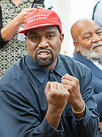Kanye West, left, makes a statement to the media as he meets with United States President Donald J. Trump, right, and NFL legend Jim Brown in the Oval Office of the White House in Washington, DC on Thursday, October 11, 2018.<br /> Credit: Ron Sachs / CNP /MediaPunch