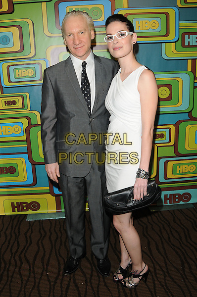 BILL MAHER & CARA SANTA MARIA.The HBO's Post Golden Globes Party held at The Beverly Hilton Hotel in Beverly Hills, California, USA..January 16th, 2011.full length white dress sleeveless grey gray suit black clutch bag glasses couple.CAP/RKE/DVS.©DVS/RockinExposures/Capital Pictures.