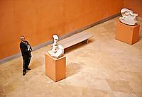 Man admiring sculpture artwork in a museum, Thyssen-Bornemisza, Museum, Madrid, Spain