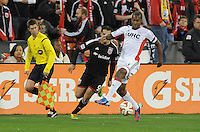 Washington, D.C.- March 29, 2014. Jose Goncalves (23) of the New England Revolution shields the ball against Fabian Espindola (9) of D.C. United. D.C. United defeated the New England Revolution 2-0 during a Major League Soccer Match for the 2014 season at RFK Stadium.