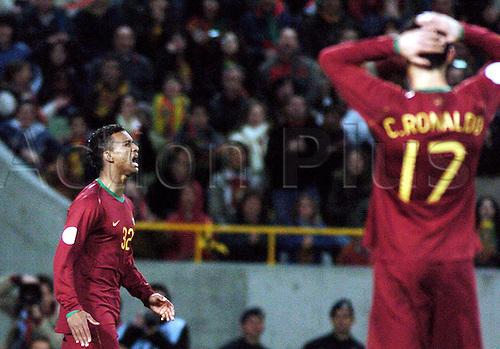 24.03.2007  Nani (Portugal)  Luis CarlAlmeida da Cunha watched by Critiano Ronaldo