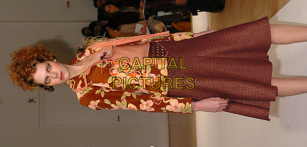 MODEL.London Fashion Week Autumn/Winter 2005/6 at the Royal Academy of Arts..Ronit Zilkha Fashion Show .February 13th 2005.half length catwalk brown beige skirt floral print jacket.www.capitalpictures.com.sales@capitalpictures.com.©Capital Pictures