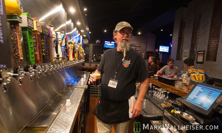 Bartender Mike Delf works at Fishale Taphouse & Grill in Panama City Beach, Florida.