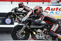 Nov. 8, 2012; Pomona, CA, USA: NHRA pro stock motorcycle rider Andrew Hines (near) races alongside teammate Eddie Krawiec during qualifying for the Auto Club Finals at at Auto Club Raceway at Pomona. Mandatory Credit: Mark J. Rebilas-