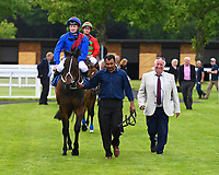 Winner of The Bathwick Tyres Handicap,Cotton Club ridden by William Carson is  led into the  winners enclosure during Afternoon Racing at Salisbury Racecourse on 13th June 2017