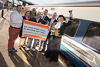 From left are Karl McCartney, Amy Codd, Bob Poynter, Chris Brown, Lawrence Bowman of East Midlands Trains and Ian Kitchen along with Lincoln Town Crier Karen Crow at the launch of the new Lincoln to Nottingham train timetable