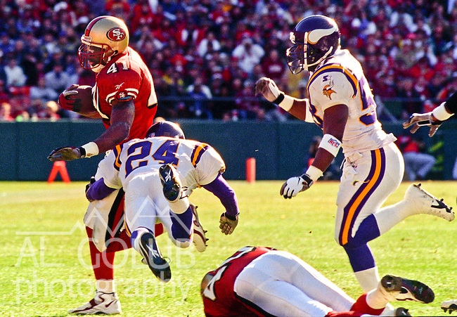 San Francisco 49ers vs. Minnesota Vikings at Candlestick Park Saturday, January 3, 1998.  49ers beat Vikings  38-22.  Minnesota Vikings defensive back Robert Griffith (24) tackles San Francisco 49ers running back Terry Kirby (41).