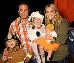 Laine and Dave Santamaria with Mac, Edie and Annie at the Little Galleria Halloween Spooktacular presented by MD Anderson Children's Cancer Hospital at The Galleria Sunday Oct. 30,2016.(Dave Rossman photo)