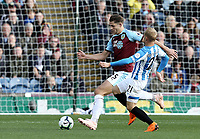Burnley's James Tarkowski is tackled by Huddersfield Town's Alex Pritchard<br /> <br /> Photographer Rich Linley/CameraSport<br /> <br /> The Premier League - Burnley v Huddersfield Town - Saturday 6th October 2018 - Turf Moor - Burnley<br /> <br /> World Copyright &copy; 2018 CameraSport. All rights reserved. 43 Linden Ave. Countesthorpe. Leicester. England. LE8 5PG - Tel: +44 (0) 116 277 4147 - admin@camerasport.com - www.camerasport.com