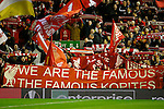 The Kop fly flags during the UEFA Europa League match at Anfield. Photo credit should read: Philip Oldham/Sportimage