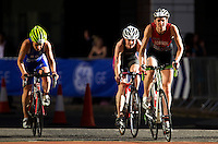 28 JUN 2012 - LONDON, GBR - Kate Robson (right) leads a pack on the bike during the elite women's heat of the 2012 Canary Wharf Triathlon in Canary Wharf, London, Great Britain .(PHOTO (C) 2012 NIGEL FARROW)