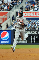 Apr 02, 2011; Bronx, NY, USA; Detroit Tigers outfielder Austin Jackson (14) hits a homerun during game against the New York Yankees at Yankee Stadium. Yankees defeated the Tigers 10-6. Mandatory Credit: Tomasso De Rosa