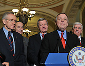 Washington, DC - December 24, 2009 -- United States Senator Dick Durbin (Democrat of Illinois) makes remarks after voting to pass H.R. 3590, regarding health care reform in the U.S. Capitol on Thursday, December 24, 2009.  The vote, which was along party lines, was 60 Democrats in favor and 39 Republicans against.  From left to right: U.S. Senate Majority Leader Harry Reid (Democrat of Nevada), U.S. Senator Chuck Schumer (Democrat of New York), U.S. Senator Max Baucus (Democrat of Montana), Senator Durbin, and U.S. Senator Christopher Dodd (Democrat of Connecticut)..Credit: Ron Sachs / CNP.(RESTRICTION: NO New York or New Jersey Newspapers or newspapers within a 75 mile radius of New York City)