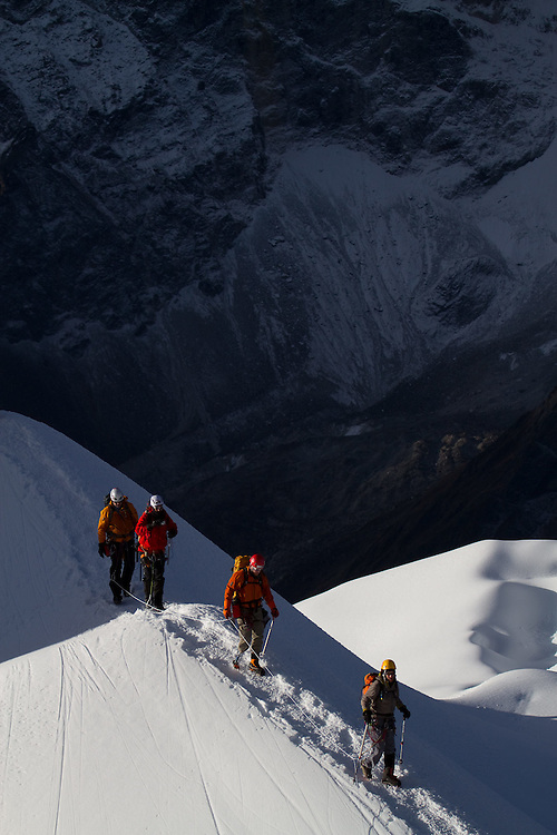 Ike Isaacson and team cruising along the lower snowfields. Photo by Didrik Johnck.