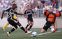 U.S. Open Cup Round of 16: DC United's Freddy Adu (9) kicks the ball against Columbus Crew goalie Bill Gaudette (31). DC United defeated the Columbus Crew in overtime 2-1, Tuesday, August 1, 2006, at Maryland Soccerplex.