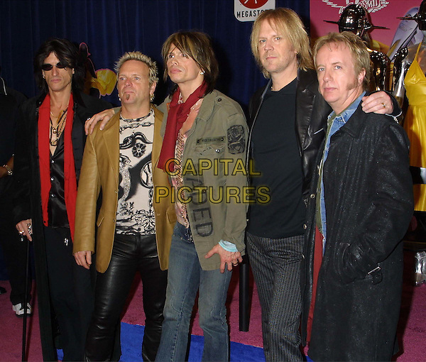 JOE PERRY, JOEY KRAMMER, STEVEN TYLER, TOM HAMILTON & BRAD WHITFORD - AEROSMITH.Attends An In-Store Signing At The Virgin  Megastore In New York City..scarf, arm on shoulders, leather jacket, half length, half-length.www.capitalpictures.com.sales@capitalpictures.com.©Capital Pictures
