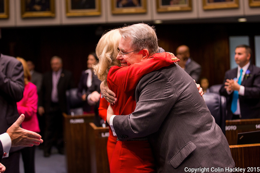 TALLAHASSEE, FLA. 3/3/15-Senate President Don Gaetz, R-Niceville, is hugged by Sen. Maria Lorts Sachs, D-Delray Beach, after the passage of the Victoria Q. Gaetz Racing Greyhound Protection Act, Tuesday at the Capitol in Tallahassee. The bill named for Gaetz' wife who is an animal advocate, requires the reporting of injuries suffered by racing dogs. <br /> <br /> COLIN HACKLEY PHOTO