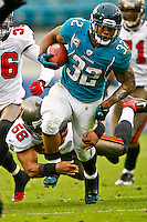 December 11, 2011:  Jacksonville Jaguars running back Maurice Jones-Drew (32) breaks the tackle of Tampa Bay Buccaneers outside linebacker Quincy Black (58) during second half action between the Jacksonville Jaguars and the Tampa Bay Buccaneers played at EverBank Field in Jacksonville, Florida.  Jacksonville defeated Tamp Bay 41-14.........