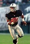 Oakland Raiders vs. Cincinnati Bengals at Oakland Alameda County Coliseum Sunday, October 25, 1998.  Raiders beat Bengals 27-10.  Oakland Raiders running back Harvey Williams (22).