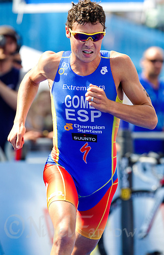 16 JUL 2011 - HAMBURG, GER - Javier Gomez (ESP) races out of transition for the start of the run during the men's round of triathlon's ITU World Championship Series (PHOTO (C) NIGEL FARROW)