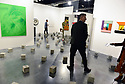 MIAMI BEACH, FL - DECEMBER 04: APeople look at artwork at the Peter Kilchmann Gallery during Art Basel Miami Beach on December 4, 2019 in Miami Beach, Florida. Art Basel represents over 250 art galleries onsite at the Miami Beach Convention Center. It is considered one of the world's largest art festivals and has art events throughout the city.  ( Photo by Johnny Louis / jlnphotography.com )
