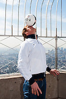 ESPN analyst and former men's national team defender Alexi Lalas balances a ball for photographers on the observation deck after flipping the switch to light the Empire State Building in the Red White and Blue colors of the US Soccer Federation during the centennial celebration of U. S. Soccer in New York, NY, on April 05, 2013.