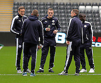 Jamie Vardy of Leicester City (C) with team mates before the Barclays Premier League match between Swansea City and Leicester City at the Liberty Stadium, Swansea on December 05 2015