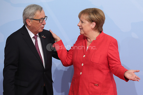 German chancellor Angela Merkel greets Jean-Claude Juncker, the president of European Commission, at the G20 summit in Hamburg, Germany, 7 July 2017. The heads of the governments of the G20 group of countries are meeting in Hamburg on the 7-8 July 2017. Photo: Michael Kappeler/dpa /MediaPunch ***FOR USA ONLY***