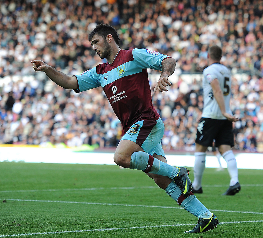 Burnley's Charlie Austin celebrates scoring his and his sides second goal in the last minutes of the match to secure a 2-1 victory ..Football - npower Football League Championship - Derby County v Burnley - Saturday 22nd September 2012 - Pride Park - Derby..
