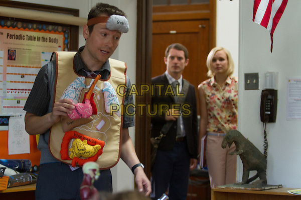 COOTIES (2014)<br /> Doug (Leigh Whannell, left), Clint (Elijah Wood, center) and Lucy (Alison Pill, right) <br /> *Filmstill - Editorial Use Only*<br /> CAP/FB<br /> Image supplied by Capital Pictures