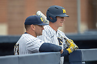 Michigan Wolverines first baseman Jimmy Kerr (15) talks with head coach Erik Bakich (23) in the dugout against the Rutgers Scarlet Knights on April 27, 2019 in the NCAA baseball game at Ray Fisher Stadium in Ann Arbor, Michigan. Michigan defeated Rutgers 10-1. (Andrew Woolley/Four Seam Images)