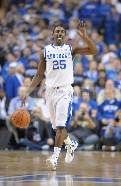 Marquis Teague (25) controls the ball during the first half of the University of Kentucky Basketball game against Loyola at Rupp Arena in Lexington, Ky., on 12/22/11. UK led at half 45-39. Photo by Mike Weaver | Staff