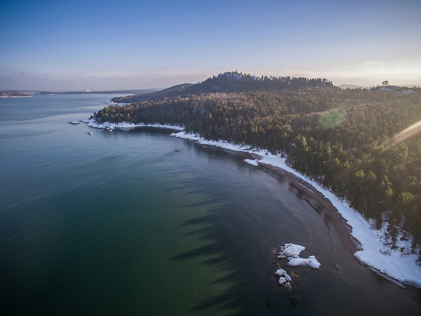 Aerial view of Lake Superior shoreline and topography near Sugarloaf Mountain and Wetmore Landing outside Marquette, Michigan.