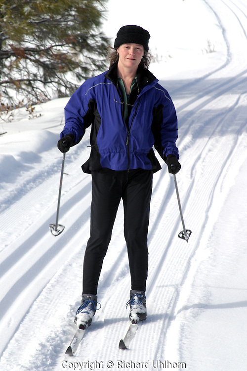 A skier concentrates on her technique on the cross-country ski trails at Echo Ridge Nordic Ski area outside of Chelan, Washington
