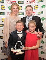 19/05/2015 <br /> Caoimhin O Donovan with sister Shona &amp; parents Kevin &amp; Luigseach with Caoimhins award<br /> during the Irish mirror pride of Ireland awards at the mansion house, Dublin.<br /> Photo: gareth chaney Collins