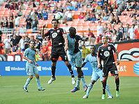 Dwyane De Rosario ( 7) of D.C. United heads the ball against Sporting Kansas City Ike Opara (3)  D.C. United tied The Sporting Kansas City 1-1, at RFK Stadium, Sunday May 19, 2013.