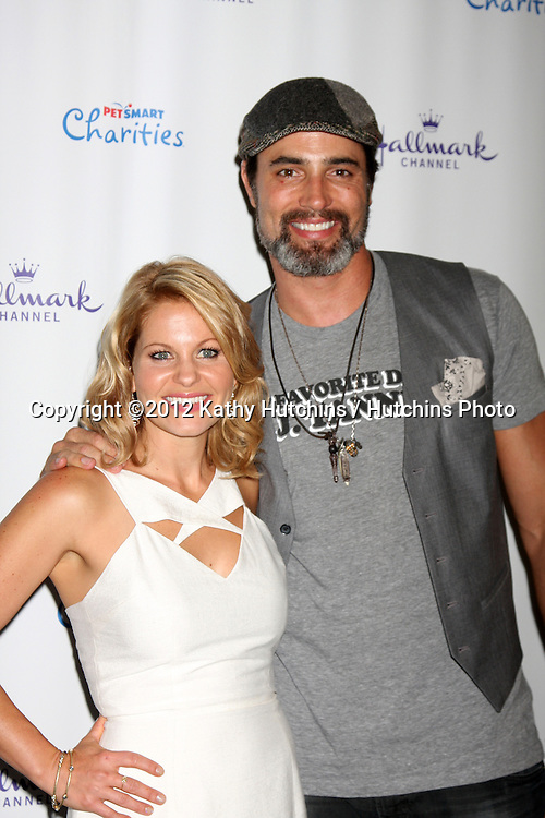 """LOS ANGELES - SEP 6:  Candance Cameron Bure, Victor Webster arrives at the Hallmark Channel """"PUPPY LOVE'"""" Private Reception at La Piazza at The Grove on September 6, 2012 in Los Angeles, CA"""