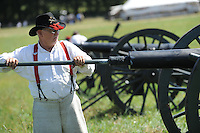NWA Democrat-Gazette/ANDY SHUPE<br /> James Neeley of Grandview, Texas, cleans one of the many cannons his family will fire Saturday, Sept. 26, 2015, during a re-enactment of the Civil War Battle of Pea Ridge in Pea Ridge. Visit nwadg.com/photos to see more photos from the weekend.